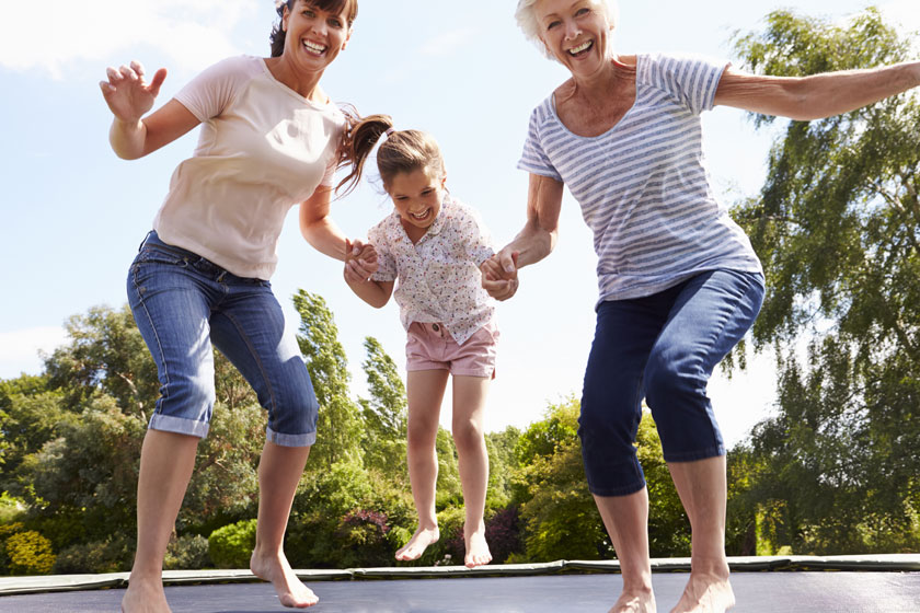 Females-jumping-on-trampoline